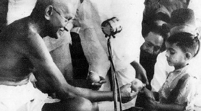 Ghandi giving