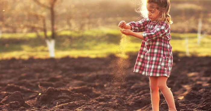 Girl playing in the dirt
