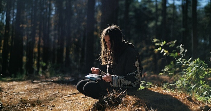 Greening the Self writing in forest