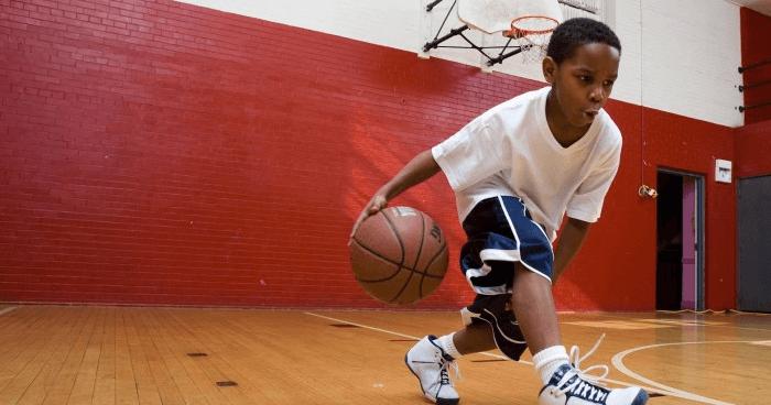 Boy training basketball