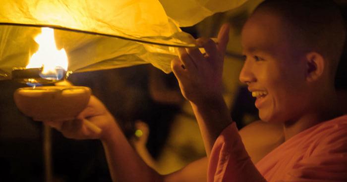 Monk releasing lantern