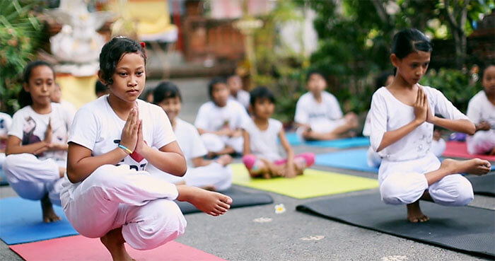 Yoga encourages happy and healthy development.