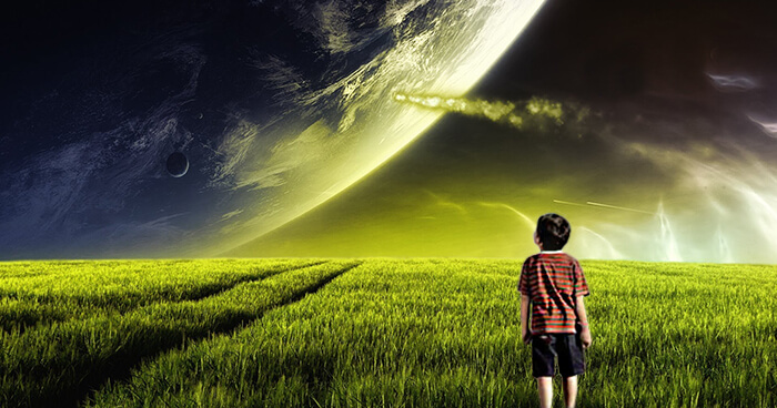 Boy looking at planet.