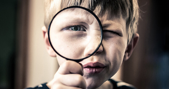 Boy with magnifying glass.