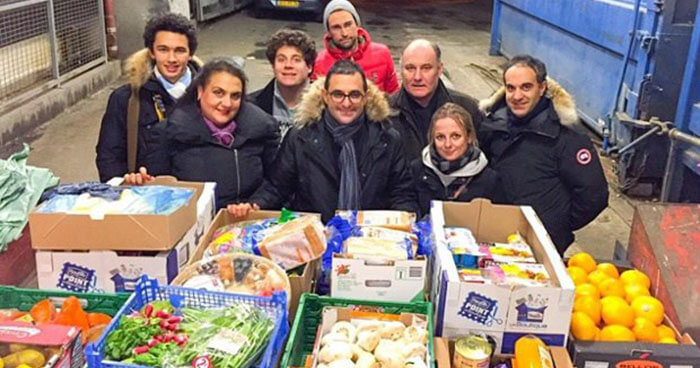 Arash Derambarsh (centre) began his drive to fight food waste and food poverty in Courbevoie.