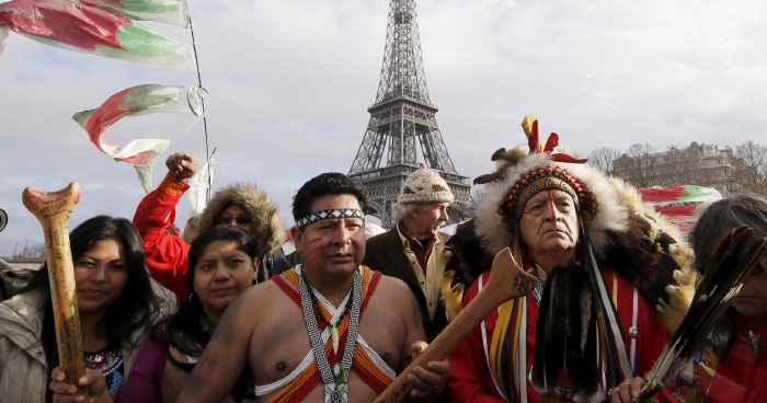 Chief Phil Lane and other Indigenous leaders at COP21 protests in Paris