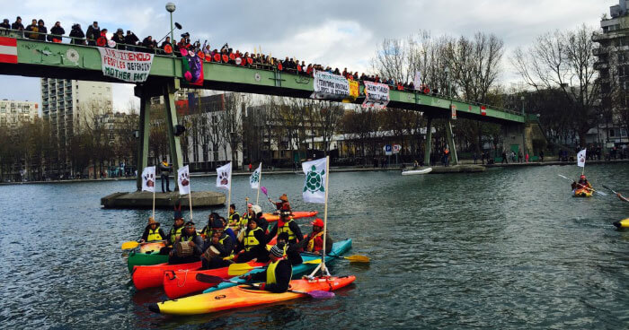 Calling for Indigenous Rights and Climate Justice on the Bassin de la Villette in Paris