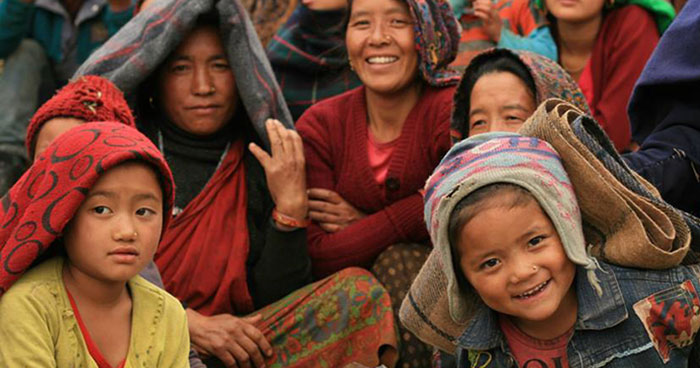 Gratefully receiving blankets fromBelievers, a network of young Nepali volunteers who deliver donated supplies