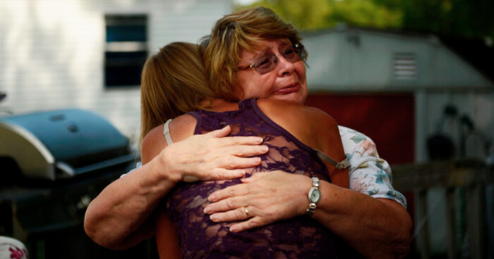 A mother hugs her addicted daughter