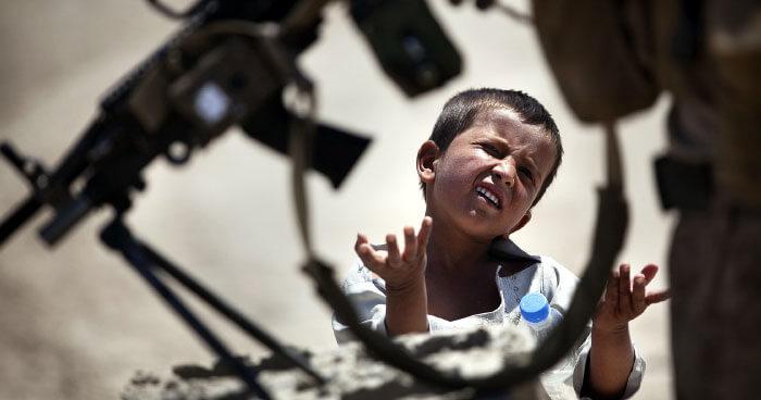 Child war soldier gun