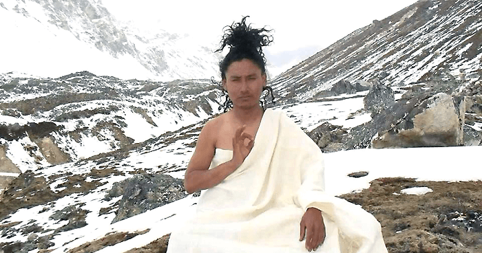 Monk meditating in the snow