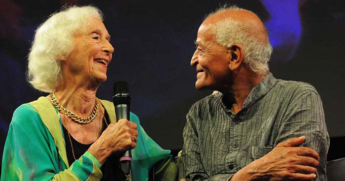 Barbara Marx Hubbard and Satish Kumar share a moment at UPLIFT 2014