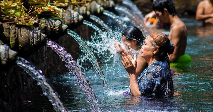 Water purification ritual at Tirta Empul temple, Bali