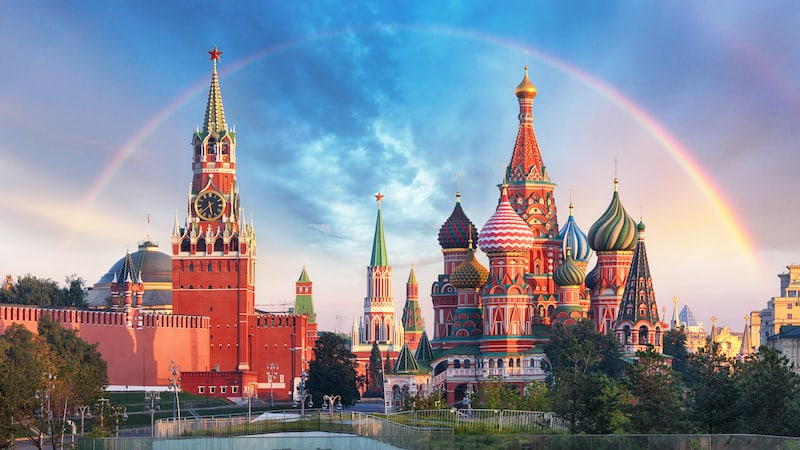 Panoramic view of the Red Square with Moscow Kremlin and St Basil's Cathedral with rainbow